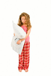 Grumpy Little Girl With Pillow