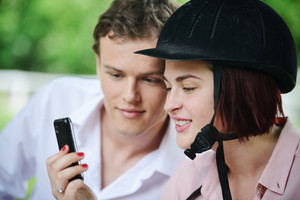 Guy and girl messaging on cell phone
