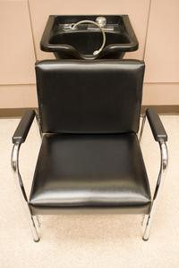 Hair Salon - a hair washing sink and chair.