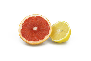 Half Cut Grapefruit And Lemon On White Background