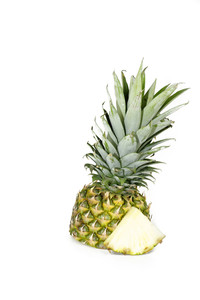 Half Cut Pineapple With Slice On White Background