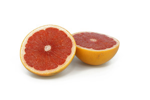 Half Cut Pink Grapefruit On White Background