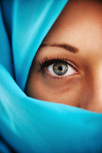 Half face in blue scarf