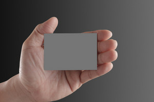 Hand Holding Blank Paper Business Card