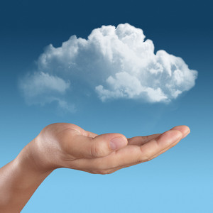 Hand Holding Cloud In Sky