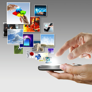 Hand Holds Touch Screen Mobile Phone Streaming Images