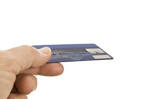 Hand Offering Debit or Credit Card