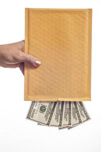 Hand Shaking Hundred Dollar Bills From Blank Envelope