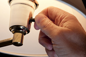 Hand Turning On Lamp