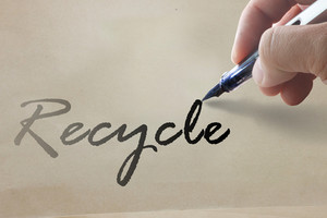 Hand Write Recycle Word On Recycle Paper