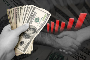 Handful of cash, profit chart, and a firm handshake. A great image to denote profits or successful business dealings.