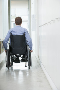 Handicapped man in wheelchair in office