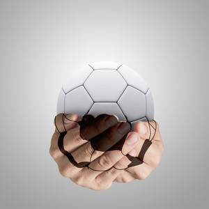 Hands Forming A Football