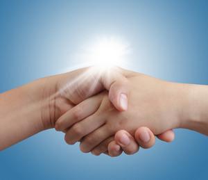 Handshake On Blue Sky And Sunlight