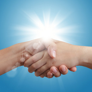 Handshake On Blue Sky And Sunlight