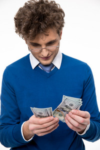 Handsome business man in glasses counting money