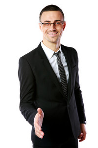 Handsome businessman offering handshake over white background