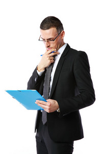 Handsome businessman reading document over white background