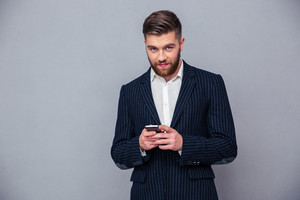 Handsome businessman using smartphone