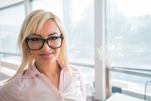 Handsome businesswoman with glasses posing
