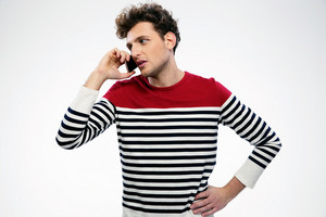 Handsome casual man talking on the phone