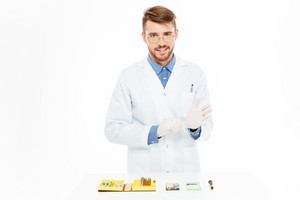 Handsome engineer reading for repair smartphone isolated on a white backgorund