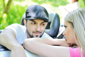Handsome guy in a car talking to a girl