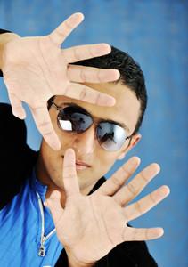 Handsome guy show hands with twelve fingers