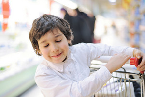 Handsome kid with his eyes closed in supermarket