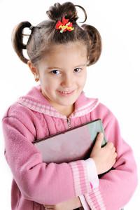 Handsome little girl holding book