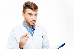 Handsome male doctor looking at camera isolated on a white background