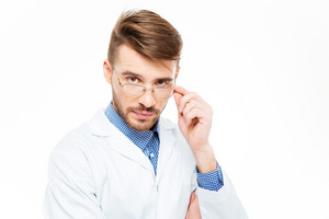 Handsome male doctor with glasses looking at camera isolated on a white background