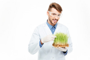 Handsome male engineer showing a modified plants isolated on a white background