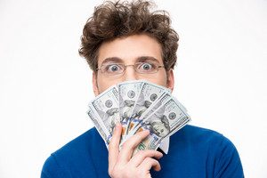 Handsome man with money over gray background