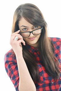 Handsome young caucasian girl isolated on white looking down her glasses