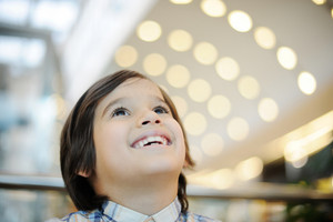 Happiness of a kid in shopping mall