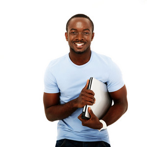 Happy african man standing with laptop over white background