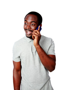 Happy african man talking on the phone isolated on a white background