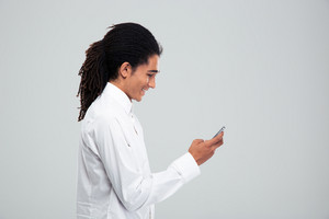 Happy afro american businessman using smartphone