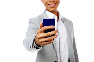 Happy asian man holding smartphone over white background. Focus on smartphone