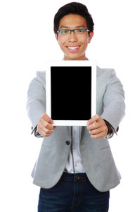 Happy asian man showing tablet computer screen over white background. Focus on tablet computer.