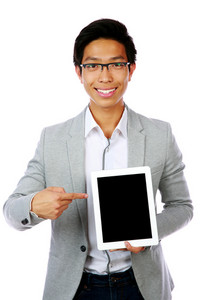 Happy asian man standing with tablet computer and pointing on it