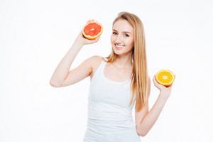 Happy attractive woman holding orange and grapefruit isolated on a white background