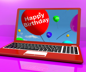 Happy Birthday Balloons On Laptop Computer Screen Showing Online Greeting