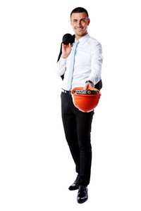 Happy businessman giving helmet at you over white background