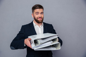 Happy businessman holding folders