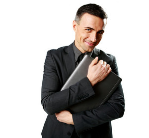 Happy businessman holding laptop isolated on a white background