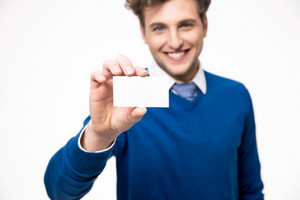 Happy businessman showing blank business card. Focus on card