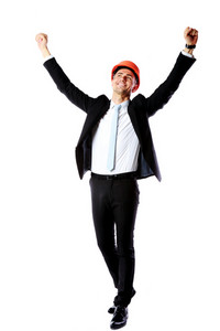 Happy businessman with hands raised over white background