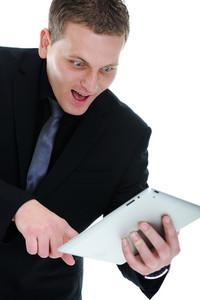 Happy businessman with ipad